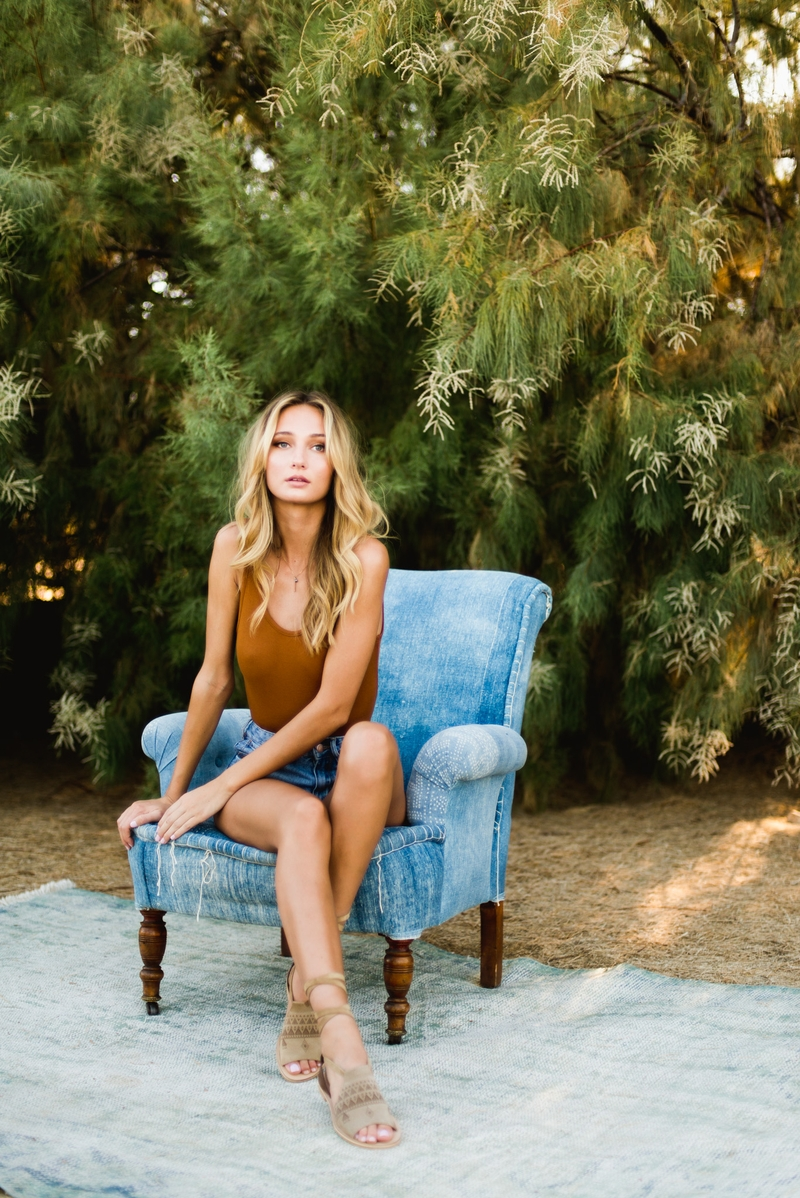 A styled shoot with Brianna Barnes on an old couch in the desert.