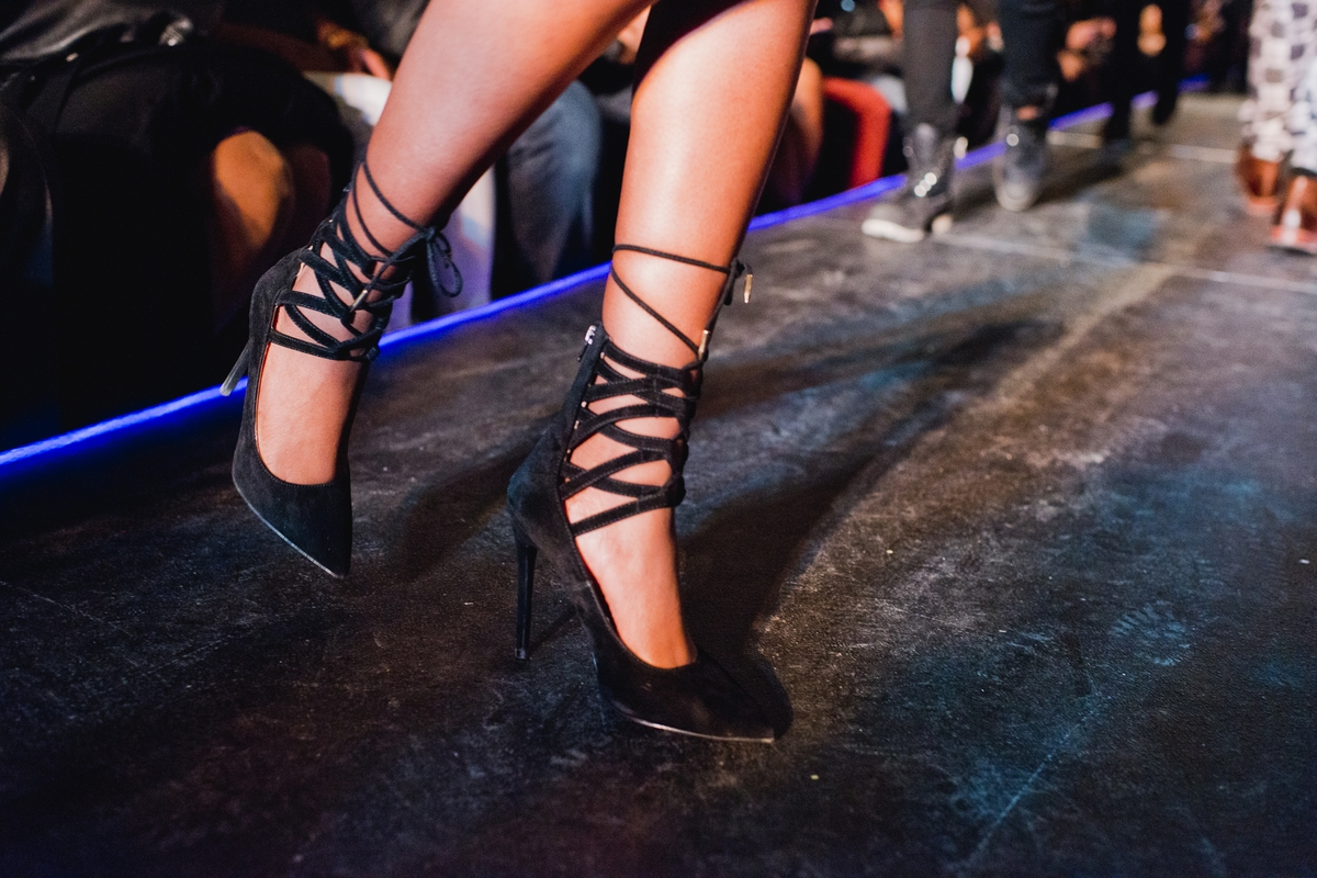 A model's black suede shoes as she turns at the end of the runway