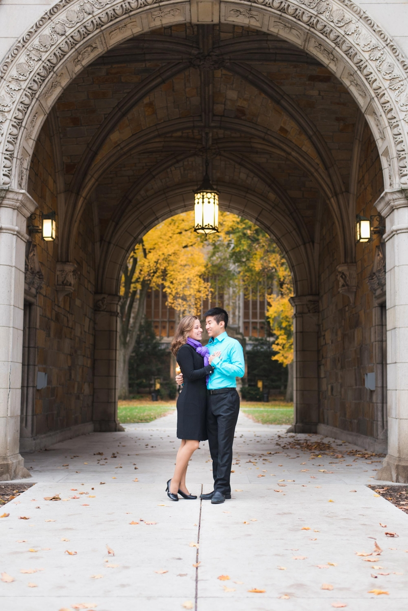 Vincent and Daisy engagement photo in Law Quad arch