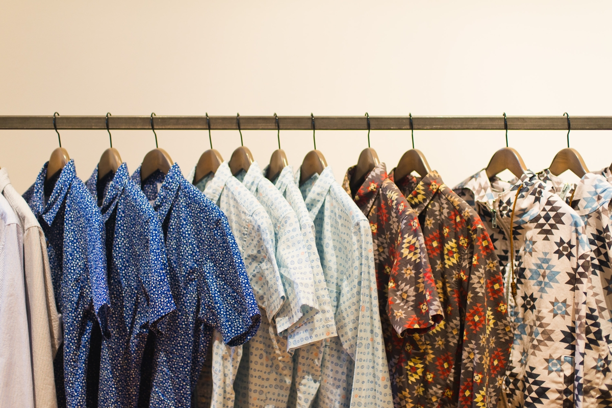 An assortment of printed shirts on a rack, from Yoshi Clothing's spring/summer 2016 line