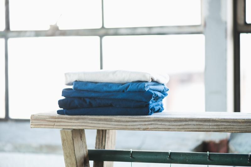 A stack of indigo-dyed shirts at Lazlo, Ponyride, Detroit